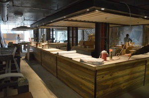 The bar in Westbound & Down Brewing Company, under construction in October, features beetle-kill pine and stone top.